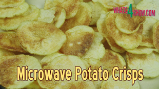 Today we're going to look at a neat trick to make salt and vinegar potato crisps in your microwave. Not only do these potato crisps have less oil content then regular crisps, but they are crispier, tastier, and a fraction of the price. You can find the printable recipe on our website http://Whats4Chow.com --- or below in this description! This is episode #774 with Whats4Chow - please subscribe for notifications and updates. Ingredients 2-3 Large potatoes 30ml Kosher salt 500ml Cheap white vinegar 500ml Water A little oil for brushing Instructions To start, use a razor-sharp knife to slice these into wafers of 1mm thickness. Using long smooth cutting strokes will result in more even slices. Pour a half liter of water and a half liter of cheap white vinegar into a large mixing bowl. Add 15ml or a tablespoon of non-iodated salt and stir this until dissolved. Add the potato slices to the salt and vinegar solution and mix them up a little to separate. Allow this to stand for 30 minutes. The salt and vinegar draws and neutralizes the starch from the potatoes, while simultaneously flavoring the slices. After 30 minutes remove the slices from the solution and arrange them over half of a clean dish towel. Fold the open half over the slices and pat them dry. Repeat this until all of the slices are dried. Place a square of baking parchment on a plate and arrange some of the slices over the parchment. Brush the slices lightly with oil, turn them over and brush the reverse sides as well. Microwave the slices on high setting. My microwave is 900 watts, and I zap my crisps for 7 minutes, turning halfway through. If your microwave is more or less powerful than this adjust the cooking time up or down accordingly. Continue microwaving batches until all of the crisps are done. The crisps will keep crispy for up to a week in an air-tight container. And there we have it, a mountain of crisps, from just 2 potatoes.